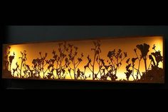 Kangaroo Paw light box by Lump Sculpture Studio. Lump uses weather proof LED strip lighting in its light boxes. Lump says prices start from about $60 per metre. An average light box uses 5-10m of lighting.
