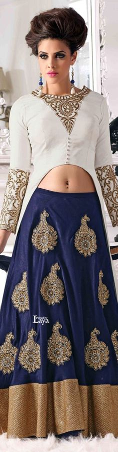 Navy blue lehenga with white and gold blouse. Indian bridal fashion.