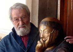 Artist Fenwick Lawson with a bronze cast of his statue of The Young Bede, unveiled at Palace Green Library, Durham. The wooden original stands in the Pontifical Beda Library College in Rome.