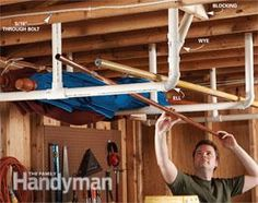 """Savvy Home Tool Storage   The Family Handyman Stow bulky items overhead by cementing together a simple rack from 2-in. PVC pipes and fittings. Bolt the straight pipe to the ceiling joists to support heavy loads, and screw the angled pieces from the """"wye"""" connectors into the cross brace to stabilize the whole rack. The PVC's smooth surface makes for easy loading and unloading."""