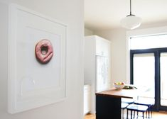 I really like this inspired kitchen renovation!  They closed a window, widened a door, and made a few other structural changes that completely changed the space.