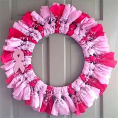 Breast cancer awareness wreath using bandanas. Show your love and support with this festive wreath. Thanks to Etsy Shop 'Crafts by Cheek' for letting us feature. #DIY #wreaths #breastcancer