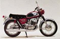 Suzuki ... 1968  T500    The air-cooled parallel-twin 500cc engine, the largest displacement of any 2-cycle engine at the time, boasted an output of 47ps at 6,500rpm. Top speed was 180km/h. Problems such as engine durability, overheating and vibration were overcome by means of Suzuki's unique technological flair, resulting in outstanding performance and making this T500 the company's flagship machine.