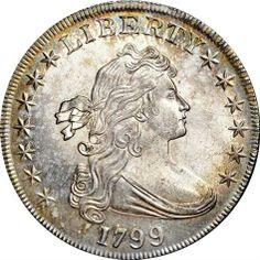 pristine 1799 silver dollar which sold for $822,500 at a 2 day New York City auction Nov. 16, 2013. The coin is on of more than 1,800 from the collection of 102-year-old Eric P. Newman, a numismatist and retired St. Louis attorney, that sold for more than $23. Much of the collection was obtained in the 1930s from the estate of a colorful collector, Col. E.H.R. Green, whose wealthy mother, Hetty Green, was known as The Witch of Wall Street.