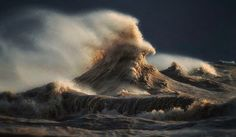 His goal was to capture the exact moment when lake waves driven by gusting winds collide with a rebound wave that's created when the water hits a pier and collection of boulders on the shore.