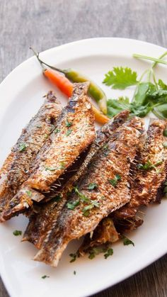 Sardines / Mathi meen marinated in chilli garlic spice mix and deep fried to crispy golden. Best served with steamed rice and spicy fish c… Fried Fish Recipes, Seafood Recipes, Indian Food Recipes, Whole Food Recipes, Healthy Recipes, Tapas Recipes, Clean Eating Meal Plan, Clean Eating Recipes, Healthy Eating