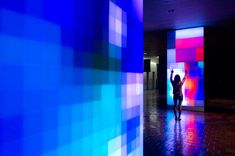 Interactive light installation by Ivan Toth Depeña in Miami. The LED lit screens sense visitors walking by and create pixellated colors that mimic their movement. Read/See more at the link. It's really incredible.