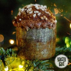A tiny panettone (technically a #panettoncino) sitting in my Christmas tree. So light and fruity this one is topped with an almond and cocoa glaze and sprinkled with sugar pearls. The inside is studded with raisins and candied lemons oranges and citrons. Check my story for a #crumbshot.  Sorry I've been so quiet of late; I've not been well. I have however been busy baking Christmas treats that I'll be posting.