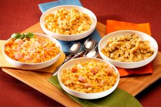 Plain Mac-n-Cheese and then three variations! Pasta Florentine adds some garlic, spinach and Parmesan cheese; there's a hint of spicy brown mustard in the Ham and Cheese variation; and Shrimp Parmesan