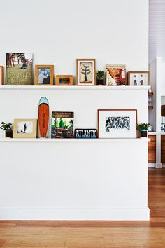 """The best way to display your precious finds is on a wall filled with shelving. Here, surfing memorabilia adds plenty of character to this [Byron Bay beach house](http://www.homestolove.com.au/gallery-kimberly-and-stephens-byron-bay-beach-house-1660 target=""""_blank""""). *Photo: Alicia Taylor*"""