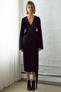 villa v neck dress with fitted waist and cone sleeve . floatie corseted belt pleated drape
