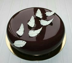 Mirror glaze cake with feathers - For all your cake decorating supplies, please visit craftcompany.co.uk