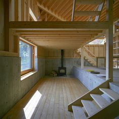 Tohma-House-by-Hiroshi-Horio-Architects The cast-concrete and timber structure of the house is left exposed on the interior, with a wood-burning stove located in one corner. Tiny House Cabin, Tiny House Living, Tiny House Plans, Tiny House Design, Cabin Homes, Split Level House Plans, A Frame Cabin, A Frame House, Small Spaces
