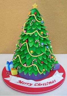 It's so bright and cheery - like the Misfit Toys will come bouncing over any second now Cake Wrecks - Home - Sunday Sweets: Merry Treats! Christmas Themed Cake, Christmas Cake Designs, Christmas Cake Decorations, Christmas Cupcakes, Christmas Sweets, Holiday Cakes, Christmas Baking, Christmas Tree, Holiday Baking