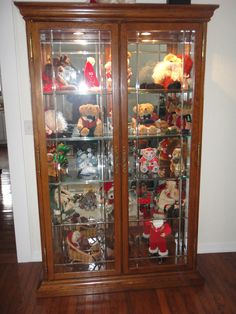 Oak Curio - Large Oak Curio with Beveled Leaded Glass on Doors, Mirror back and 4 gla... #ReferLocal