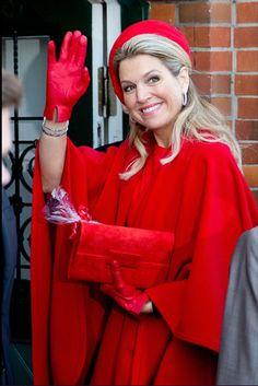 Queen Maxima of the Netherlands waves to the citizens during state visit on March 20, 2015 in Hamburg, Germany.