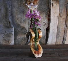 Hey, I found this really awesome Etsy listing at https://www.etsy.com/listing/222195196/rustic-log-serpentine-vase-aspen-wood