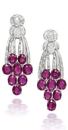 A pair of ruby and diamond earrings |  #luxury #diamond  #jewels