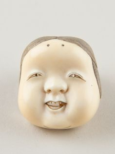 Netsuke of Kyōgen Mask; Usume (or Okama or Ofuku), 19th century, Ivory, Japan.