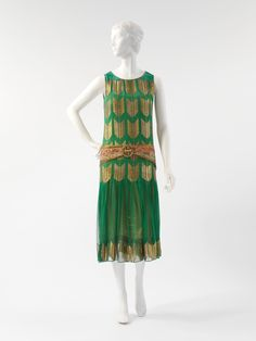 """omgthatdress:  Paul Poiret """"Arrow of Gold"""" evening dress ca. 1924-1925 via The Costume Institute of the Metropolitan Museum of art  I love green and gold together."""