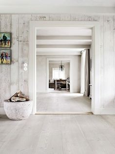 whitewashed wooden walls and floors