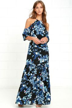 The Ali & Jay Nicky Navy Blue Floral Print Maxi Dress is taking the style scene by storm! Woven poly, with a stunning navy blue, cream, pink, and beige floral print forms a high neckline framed by cold shoulder cutouts and flouncing short sleeves. Elasticized waist gives way to a tiered maxi skirt. Back keyhole with clasp closure.