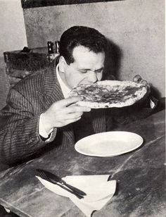 vintage man eating large pizza all by himself