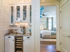 Same house, different view. Beverage station/kitchen into the master bedroom. House of Turquoise.