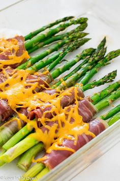 Your next go-to side dish; salty, savory prosciutto wrapped around tender, roasted asparagus and topped with melted cheddar cheese.