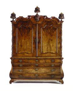 A DUTCH WALNUT CABINET - ROCOCO, SECOND HALF 18TH CENTURY.