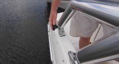 Bayliner 215 DB: By removing a nut at the rear arch support, the wakeboard tower is able to collapse towards the windshield reducing the clearance so that the 215 DB can fit into a garage. Hint… wait till the boat is on the trailer to remove the nut.