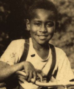 "a young emmett till. He was such a cutie. Destroyed by ""God loving"" people..they'll share NO part of the Kingdom."