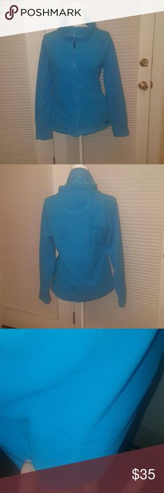 Calvin Klein Performance blue fleece jacket small Calvin Klein Performance zip up blue fleece jacket. Size small.   Great used condition, small blue ink? Stain near the bottom on the back, hardly noticeable against the blue material, 3rd pic.  Great for workouts or  casual wear. Bundle and save!! Calvin Klein Jackets & Coats