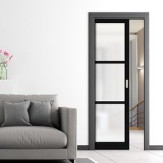 Industrial style pocket doors with a steel look but with the warmth of wood, perfect for a loft or warehouse conversion. Pocket Door Frame, Pocket Door Pulls, Pocket Doors, Internal Sliding Doors, Sliding Door Hardware, Sliding Glass Door, The Doors, Panel Doors, Frosted Glass Door