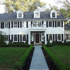 Classic white beauty restored with new dormers, windows, and shutters  - Alfano Renovations