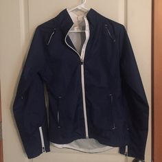 Blue windbreaker jacket Never worn blue windbreaker jacket. Mesh lined with lots of vents throughout the jacket for air flow. Great running jacket! Danskin Jackets & Coats