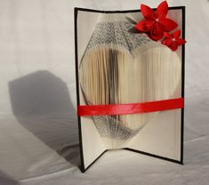 Book folding art - heart from book with red origami flowers Book folding art – heart from book with red origami flowers by NicePaperArt on Etsy Diy Origami, Heart Origami, Paper Origami Flowers, Anniversary Decorations, Book Folding, Paper Decorations, Book Art, First Love, Glass Vase