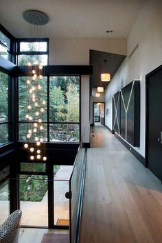 Large glass facade, glass railings, black trim and doors