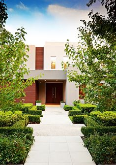 Exterior, Elegant A Stunning Retreat Home Narrowed Walk Way Constructed Between Short Manicured Greenery: Extraordinary Modern Exterior House with Swimming Pool