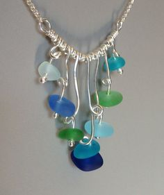 Waterfall Necklace ~ a stunningly fluid piece!    Each is One of a Kind ... however each is made in the same style.  7 drops of 18g, sterling wire is balled on the end by torch ~ and gracefully shaped  to hold the recycled beach glass in place ~ with the feel of falling water. The drops move freely and fluidly ~    Each drop is separated by shiny beads of sterling silver and attached to Sterling Silver rollo chain ... choose either 16 or 18    Arrives gift packaged with artisan & info cards…
