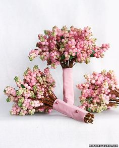 These pink snowberry bouquets would be great for #bridesmaids