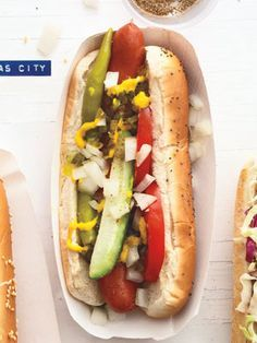 Chicago Dog...The Windy City likes its beef hot dog cooked on a griddle, set in a poppy-seed bun, slathered with mustard, and garnished with chopped white onion, sweet relish, a dill pickle spear, tomato slices, sport peppers (small hot peppers) and celery salt.