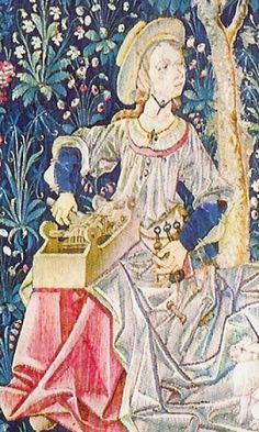 La Noble Pastoral. Woman either spinning (doesn't look like a wheel or spindle to me) or with a box loom (more likely). Detail from 'Le Travail de la Laine' tapestry, 16c. France. Interested in her loose gown, which is very different than I've seen before.