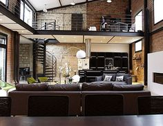 Exposed brick loft! I love it, but the first thing that would happen? Lots of purple, hot pink, blue, and green throughout, accented by all the black that's already there. #boycottneutrals #livelifeboldly