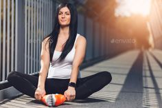 City workout. Beautiful woman with a smartwatch training in an urban setting by tommyandone. City workout. Beautiful young woman with a smartwatch training in an urban setting