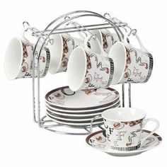 """A lovely addition to your dining room sideboard or baker's rack, these espresso cups feature a complementing stand.   Product: 6 Espresso cups, 6 saucers and standConstruction Material: Porcelain and metalColor: White, brown and silverDimensions: 9"""" H x 7"""" W x 5"""" D (overall)"""