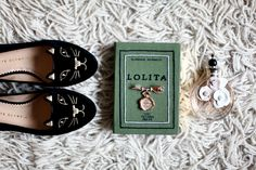 Everything about this screams me. Cat flats, Lolita Book Clutch and vintage pins...subtle floral scents.. ;)