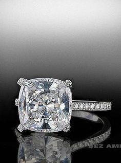 Cushion cut center diamond in pave mounting.  By Bez Ambar.