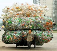 A Chinese man transports plastic bottles and containers for recycling in Haikou, the capital of China's southern Hainan province. Bizarre, Wise Owl, People Of The World, Save The Planet, Plastic Bottles, Water Bottles, Empty Bottles, Belle Photo, Mother Earth