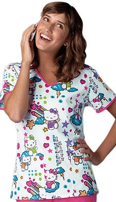Style Code: (CH-6546HK) A fit and flare printed scrub top from Cherokee Uniforms is featured in a v-neck style and long set-in sleeves. This fashion scrub top is designed with two functional front pockets wherein you can place your handy paraphernalia and other personal items. Also features contrast binding edges neckline and sleeves for some accent and additional detail.